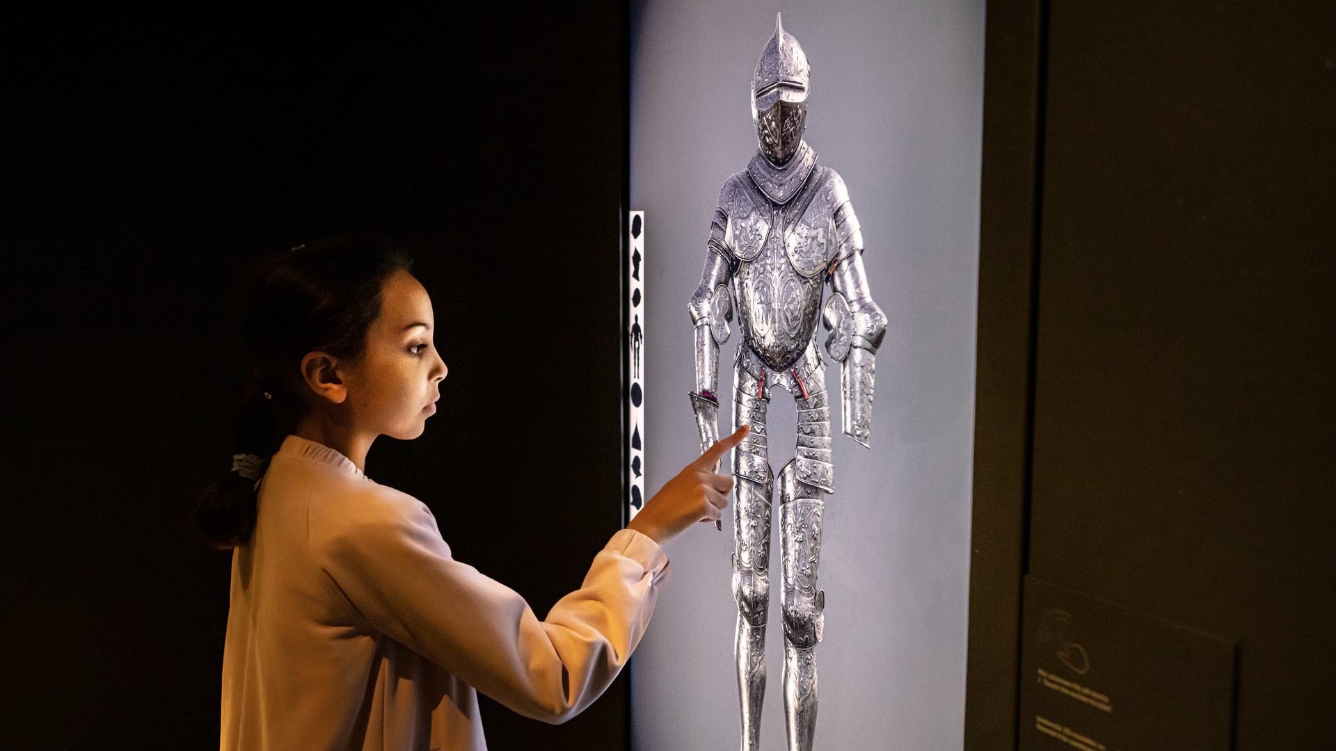 A child in front of a touch screen.