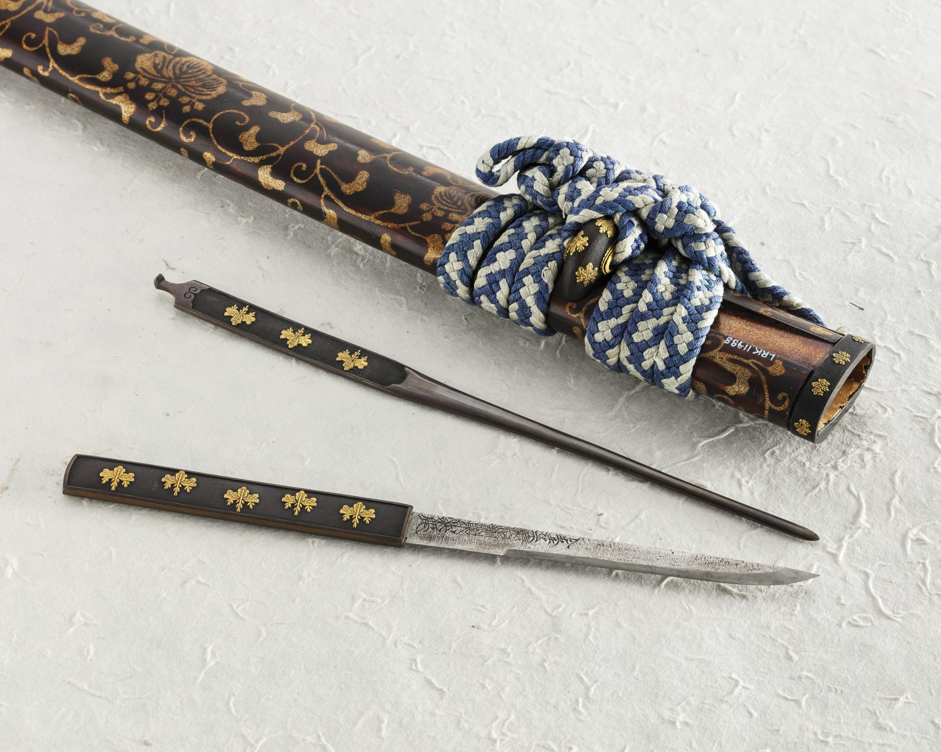 A scabbard with two small implements.