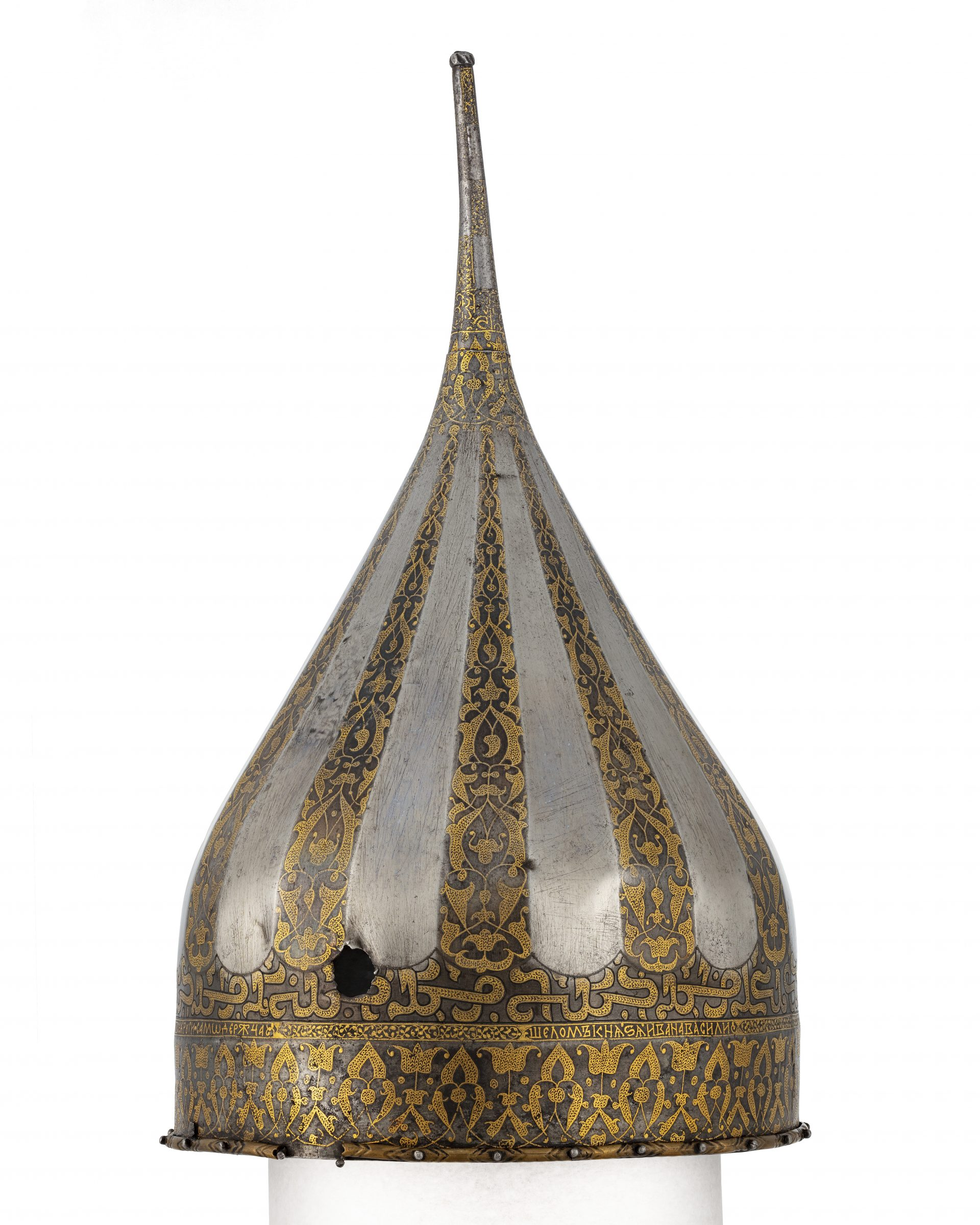 A spiked helmet of steel with gold ornaments.