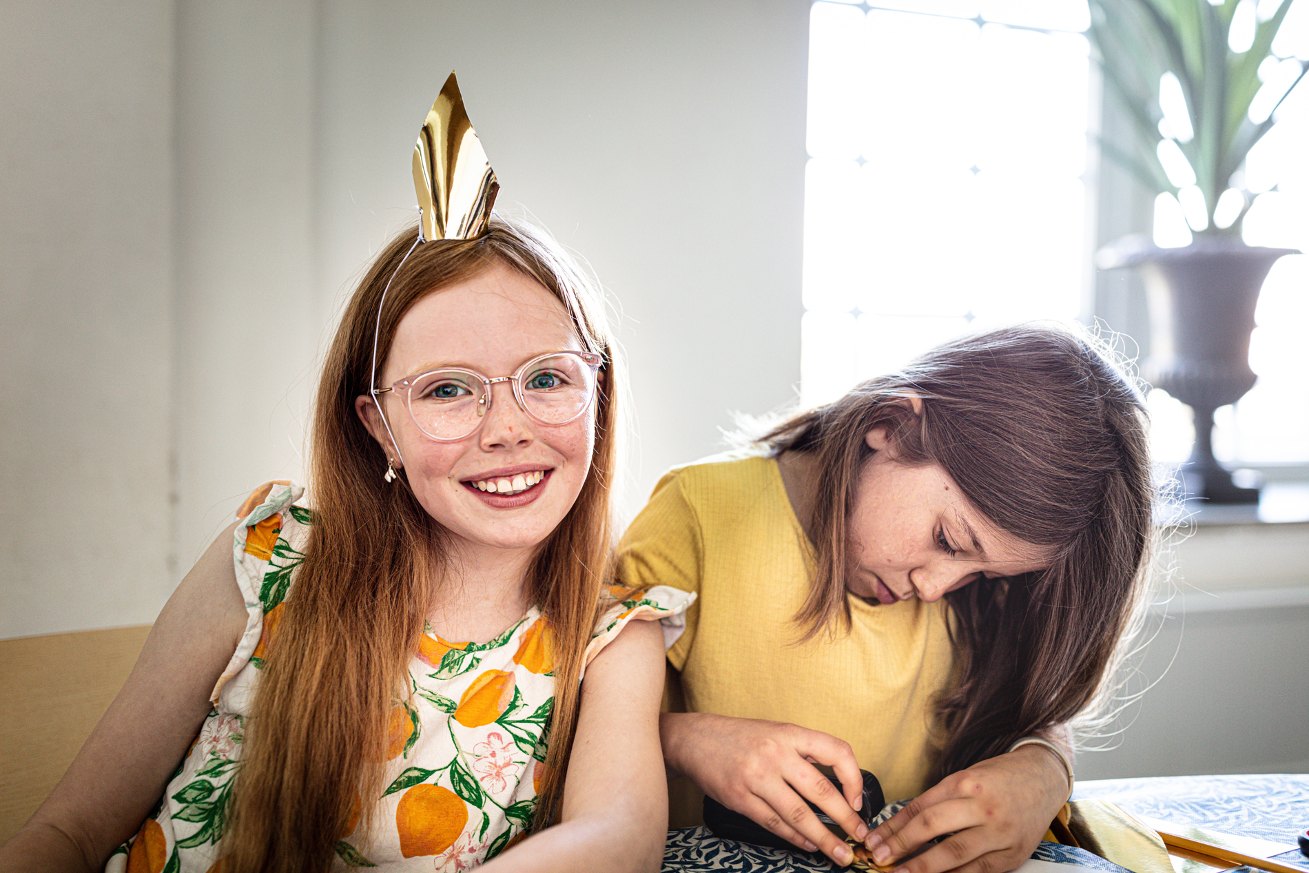 Two children doing crafts.